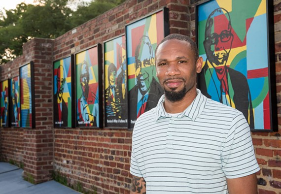 Artist Hamilton Glass stands by the Legacy Wall outside the Bon Secours Sarah Garland Jones Center located at 2600 Nine Mile Rd.