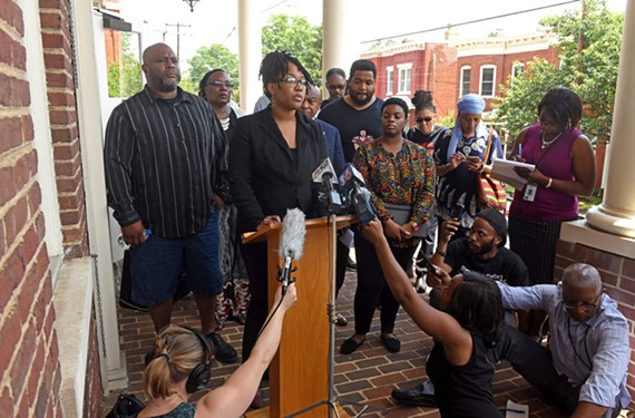 Princess Blanding, sister of Marcus Peters, addresses a crowd of reporters shortly after the footage of her brother's death is released.