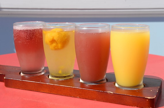 The Fancy Biscuit's mimosa flight includes classic, pomegranate, raspberry-mint and mango-passion fruit.