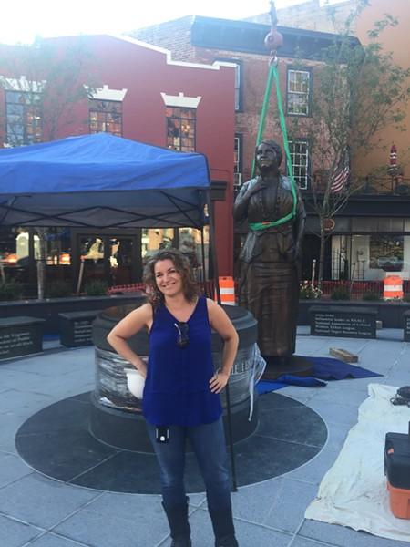 Ellyn Parker, former city public art coordinator, stands in front of the Maggie Walker statue in Jackson Ward. - DEE DEE JOHNSON