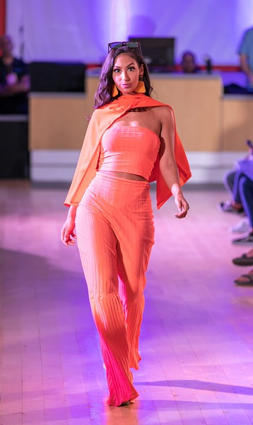 Model Menddy Mercado, also wearing Swan, walks the runway at Stony Point Fashion Park. - MICHAEL HOSTETLER PHOTOGRAPHY