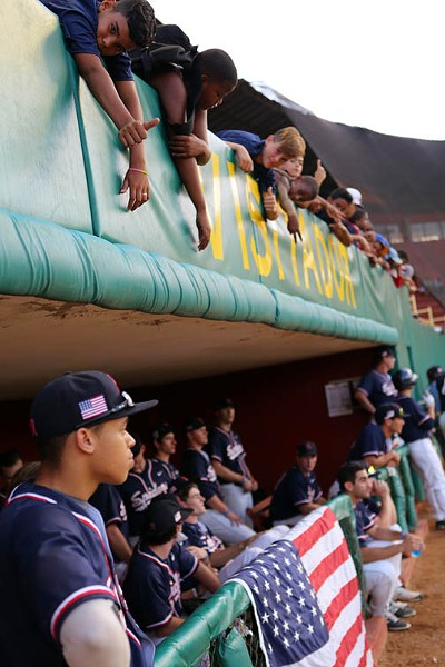 With young Cuban fans leaning in, Caleb Ward watches game one begin in San Jose against Los Hurucanes. - UNIVERSITY OF RICHMOND ATHLETICS