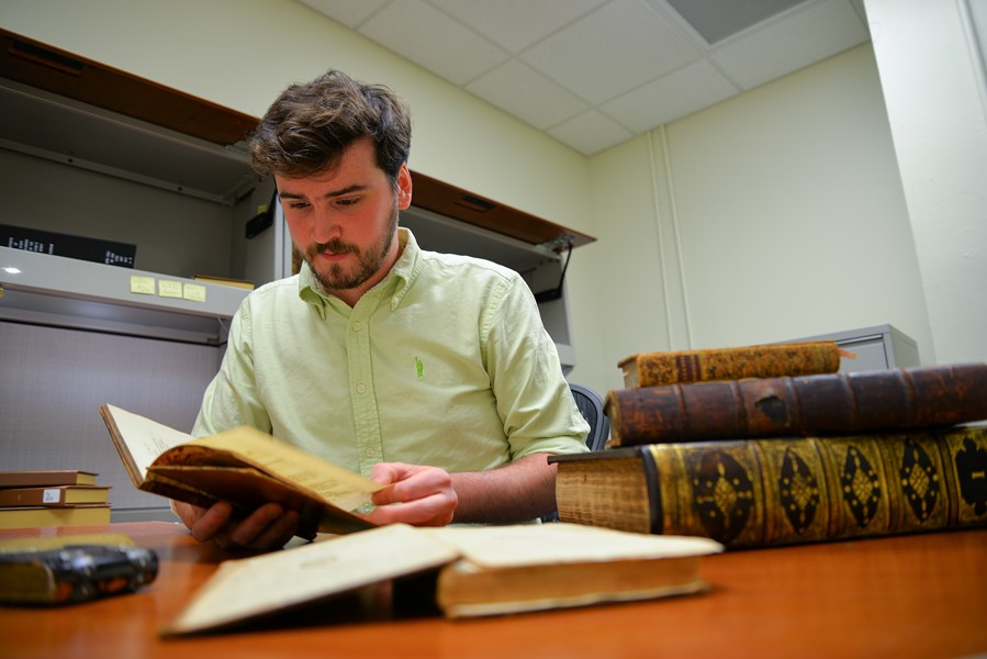 Julian Neuhauser, a VCU English graduate student, made it his mission over the last year to catalog VCU Libraries' collection of pre-1800 printed books.