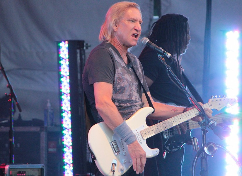 After granting media passes, Joe Walsh's people changed their mind and wouldn't let local media near the photo pit, so this photo was taken from a distance away during his Innsbrook performance. - BRENT BALDWIN