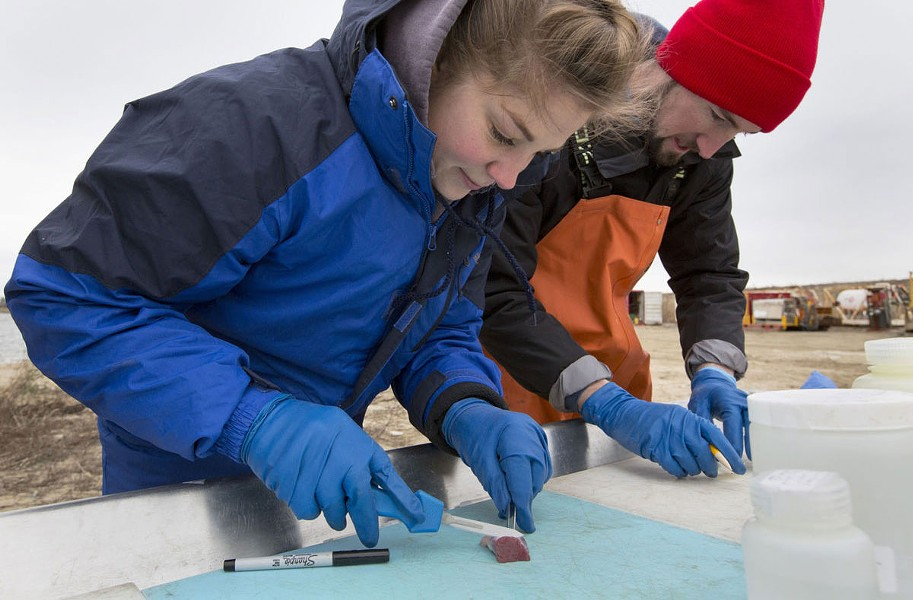 Farah Rose and Steven Thornton of the Virginia Aquarian's Stranding Response team prepare to label a sample during the necropsy. - THE' N. PHAM
