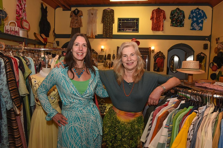 New owner of Halcyon, Didi Chisholm (left) stands next to original owner, Connie Carroll, in the shop at 117 N. Robinson St.