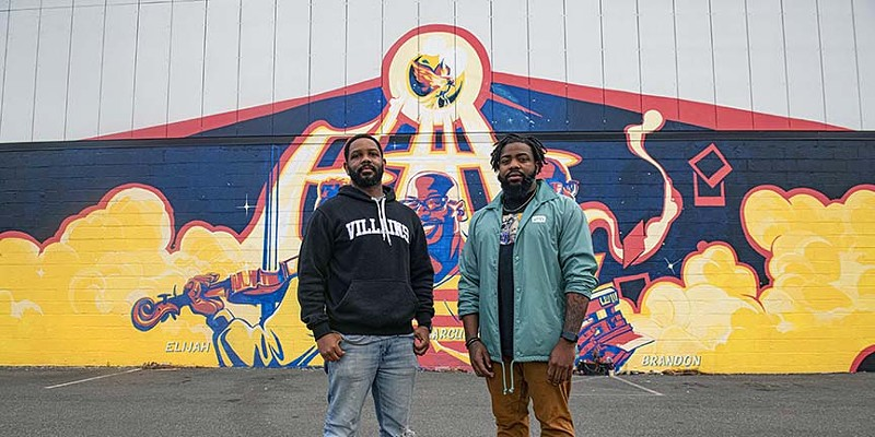 Capsoul Collective founders Eric Jackson and Tyrel Murdaugh stand before the Chris Visions mural behind Bingo Beer in Scott's Addition.