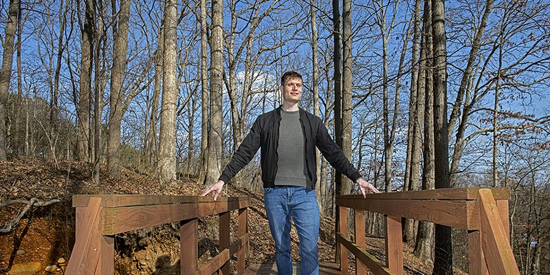 Dominik Kulusic, a German graduate student, hiked and cycled all of Virginia's state parks during the past 12 months (pictured here in Richmond).