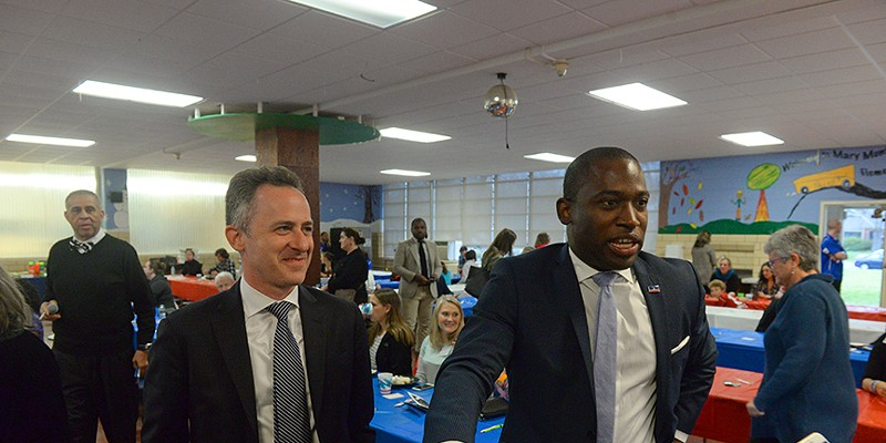 Richmond Public School Superintendent Jason Kamras with Mayor Levar Stoney before addressing a crowd at Mary Munford Elementary School in 2018.