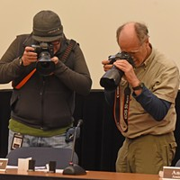 Virginia House of Delegates Random Drawing Photographers Rob Ostermaier from the Daily Press and Tim Wright from the  Washington Post document the film canisters used in the drawing. Scott Elmquist