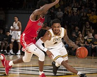 VCU's Marcus Evans (No. 2) drives on Randall Gaskins (No. 4) of St. Francis. Evans was a preseason all-Atlantic 10 first team pick.