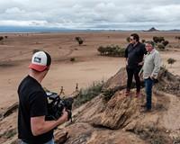 """The Good Road "" hosts Craig Martin and Earl Bridges overlook a Masai village on a Kenya Trek."