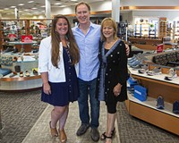 Gary and Beth Weiner stand with their daughter Amanda inside the long-running Saxon Shoes.