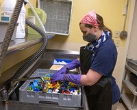 Ann Marie Chevalier sanitizes toys from the day care at Bon Secours St. Mary's Hospital.
