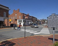 Small businesses in restored buildings characterize Valley Road, which intersects with Main Street in Scottsville, a small town that straddles the border between Albemarle and Fluvanna counties at a bend in the James River.