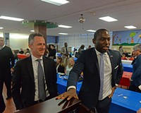 Richmond Public School Superintendent Jason Kamras with Mayor Levar Stoney before addressing a crowd at Mary Munford Elementary School in 2018.