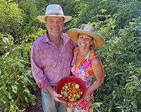 David Hunsaker and Barbara Hollingsworth at Village Garden RVA Farm in Hanover with the first harvest of the year.