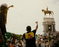"""A still of protesters at the Lee monument from the documentary, """"How the Monuments Came Down."""""""