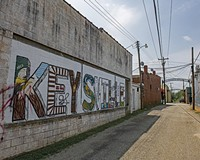 A celebratory mural adorns the side of a building on Main Street in Keysville.