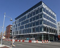 The Current, a mixed-use complex, designed by Hickok Cole Architects of Washington, in the 400 block of Hull Street combines office spaces, 215 apartments and a food hall.