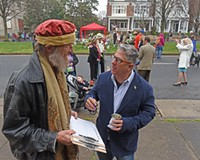 Alan Schintzius snags a petition signature from Charlie Diradour, developer and former candidate for council, at Easter on Parade.