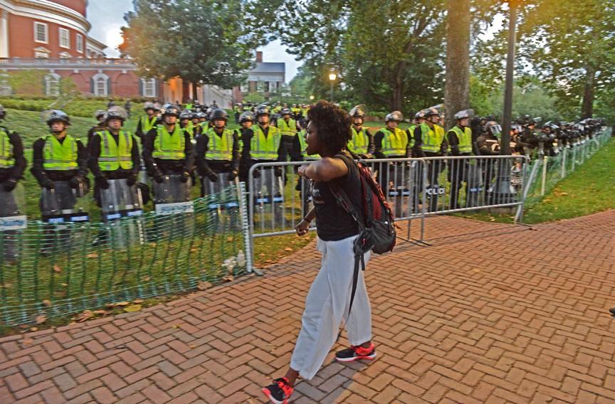 A protester emotionally confronts Virginia State Police near UVA's Rotunda. - SCOTT ELMQUIST