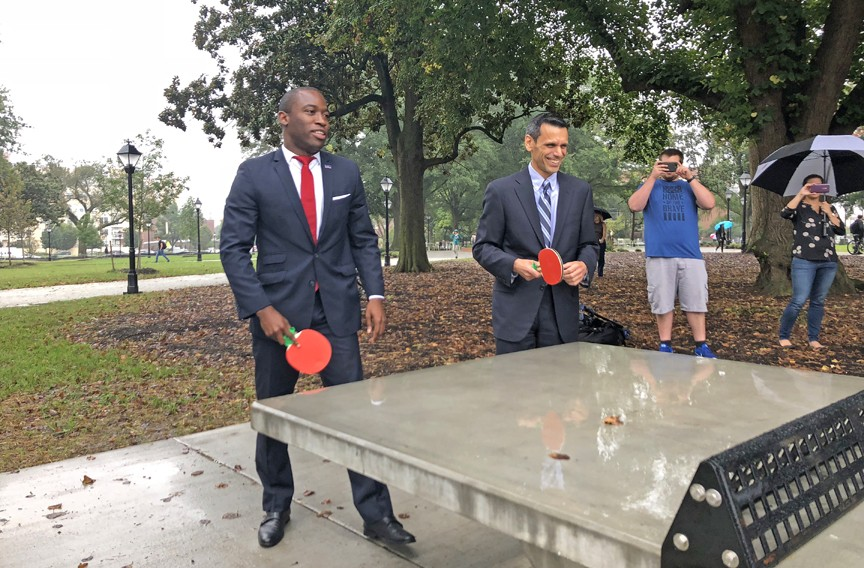 Ping-pong diplomacy: Mayor Levar Stoney and Michael Rao, VCU president, inaugurate the park's table tennis amenity on Sept. 27. The city owns Monroe Park and the university will assist in maintaining it. - SCOTT ELMQUIST