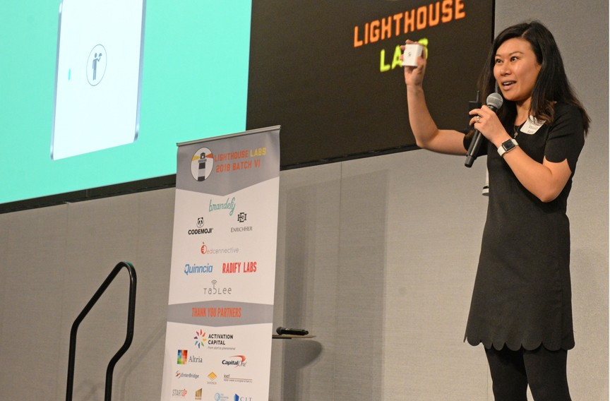 Wendy Jiang explains her idea at the Lighthouse Labs' annual pitch-off held at Capital One's West Creek campus. She won third place for Tablee, a button which allows restaurant patrons to notify their servers. - SCOTT ELMQUIST
