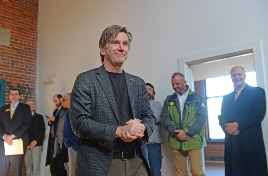 Walter Parks attends the Jan. 11 opening ceremonies for the first phase of Port City on U.S. 1. The project is redeveloping 11 acres of former tobacco factories into 135 housing units. - SCOTT ELMQUIST