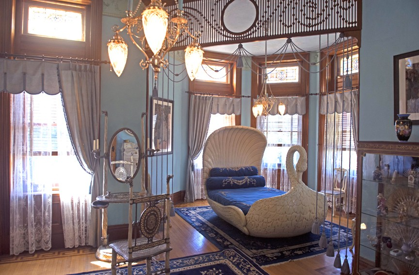 Sallie Dooley's bedroom is furnished with a swan bed, one of the most intriguing attractions of the interior. It was once housed at the Dooleys' summer home. - SCOTT ELMQUIST