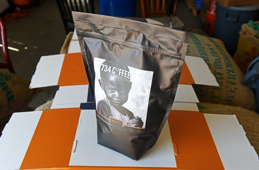 734 Coffee is named after the geographical coordinates (7 degrees north, 34 degrees east) for Gambela in Ethiopia, where Kher was a refugee for 13 years. The image of a young Sudanese boy on the package aims to bring attention to refugees. - SCOTT ELMQUIST