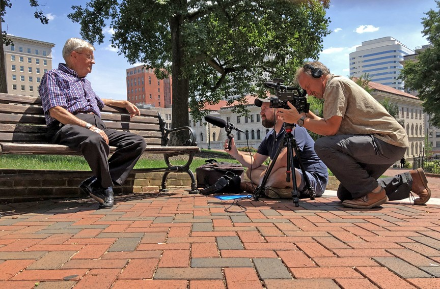 At Capitol Square, Otis Brown shares behind-the-scenes stories about how Virginia handled the Kepone crisis with filmmaker Bernard Crutzen and Jason Roop, assisting. Brown, who served as secretary of health and human services, continued to manage the issue after his retirement in 1977 at the request of Gov. Mills Godwin. - SCOTT ELMQUIST