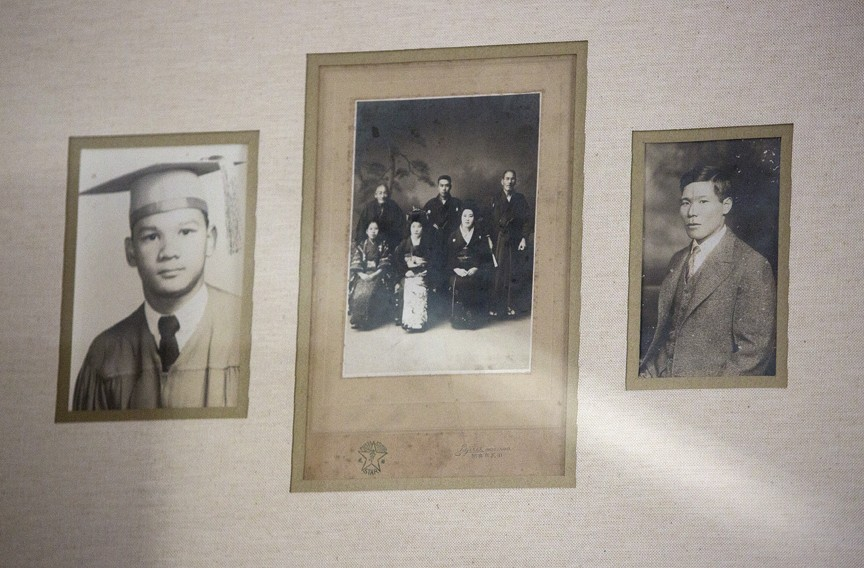 Family photographs in Regina H. Boone's Richmond home feature her father, Raymond H. Boone, at left, and her grandfather, Tsuruju Miyazaki, at right. The middle photograph is a family portrait from the wedding of Miyazaki's sister. Raymond was 3 when Miyazaki was arrested in Suffolk on Dec. 7, 1941, and taken away. - KAITLIN MCKEOWN