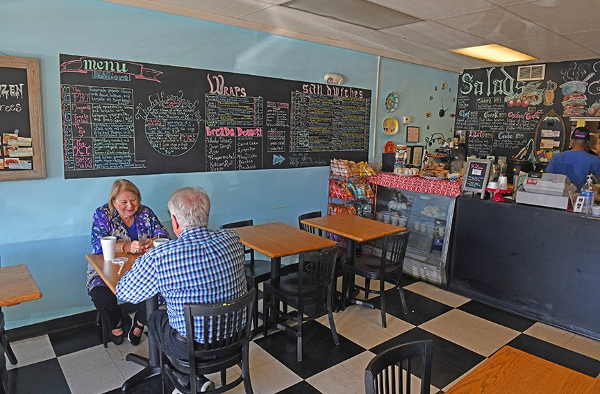 Inside the tiny eating area at the original Patterson Avenue location. - SCOTT ELMQUIST