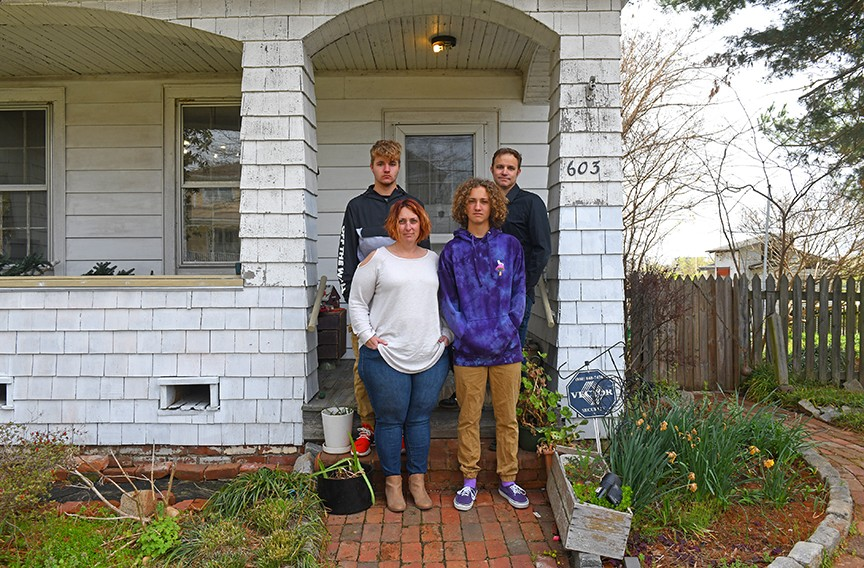 Jessica and Jason Hendricks and their teenage sons, Aiden, at front, and Garrett, are adapting to home offices and completing their high school semesters, respectively. - SCOTT ELMQUIST