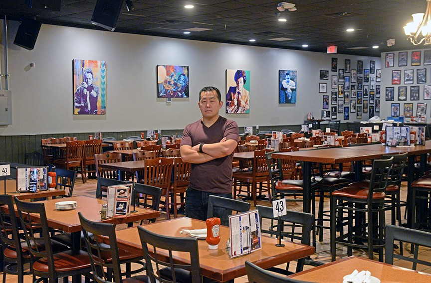 Richmond restaurateur Kevin Liu stands in one of his temporarily shuttered businesses, live music venue the Tin Pan. - SCOTT ELMQUIST