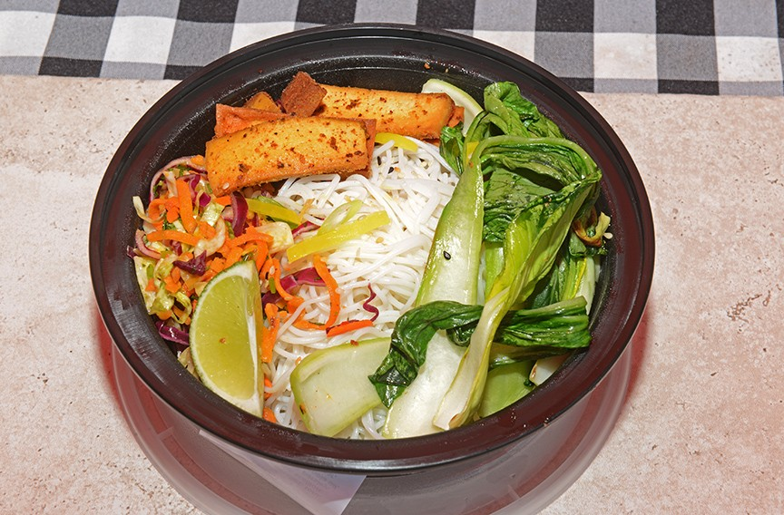 Rice noodle bowl with peanut sauce, bok choy and marinated tofu. - SCOTT ELMQUIST