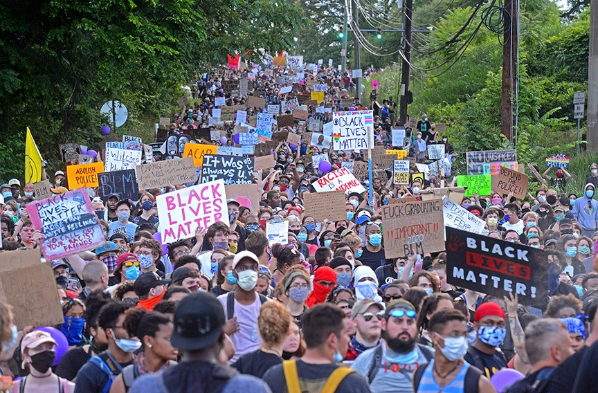 Protesters march down Hospital Street bound for the city jail on June 5. - SCOTT ELMQUIST