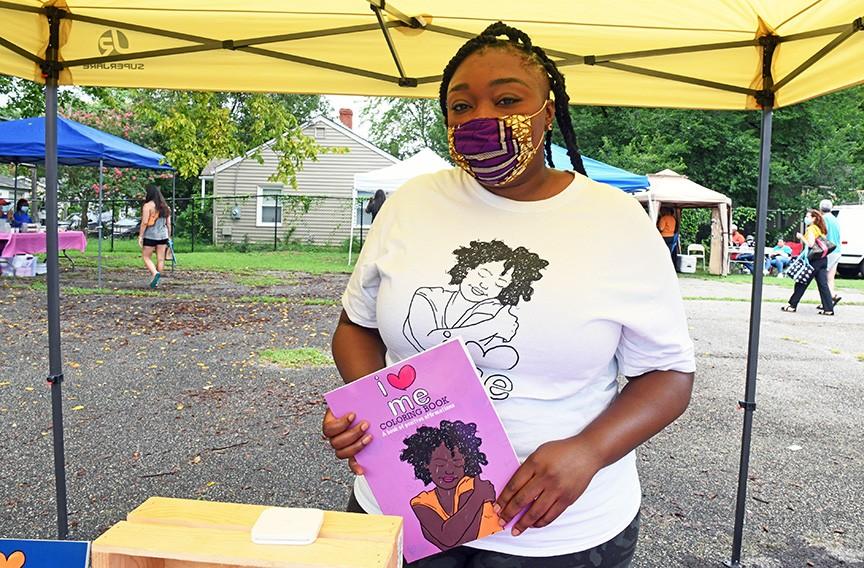 "Sherrell Satterthwaite holds her popular, self-published ""I Love Me Coloring Book."" - SCOTT ELMQUIST"