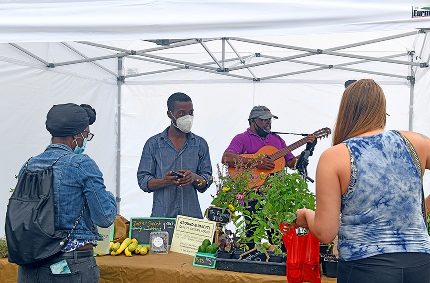 Local farmer Kyle Epps works the Ground & Palette table at the RVA Black Farmers Market in the parking lot at 1700 Blair St. - SCOTT ELMQUIST