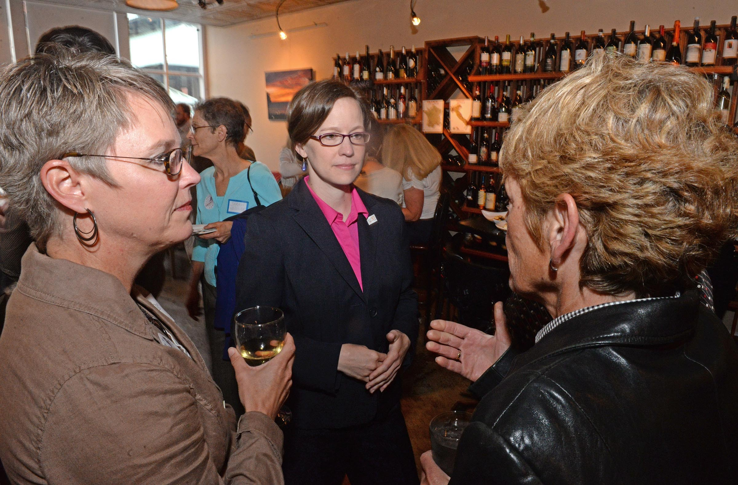 "Candidate Emily Francis meets with supporters at C'est Le Vin in Shockoe Bottom. She says she's ""the only true progressive in the race."" - SCOTT ELMQUIST"