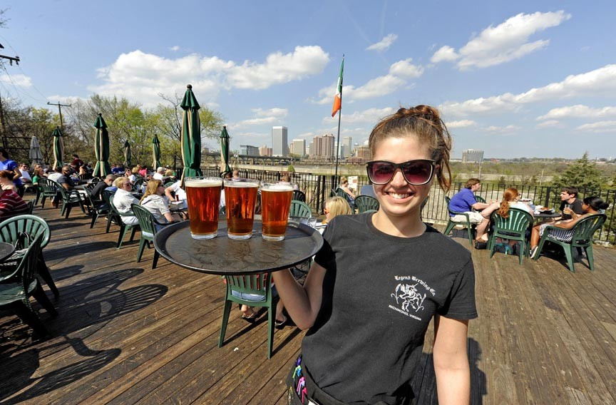 Alexis Rinehardt serves beer on the deck at Legend, a long-running favorite for its deck, view and local craft brew. - SCOTT ELMQUIST