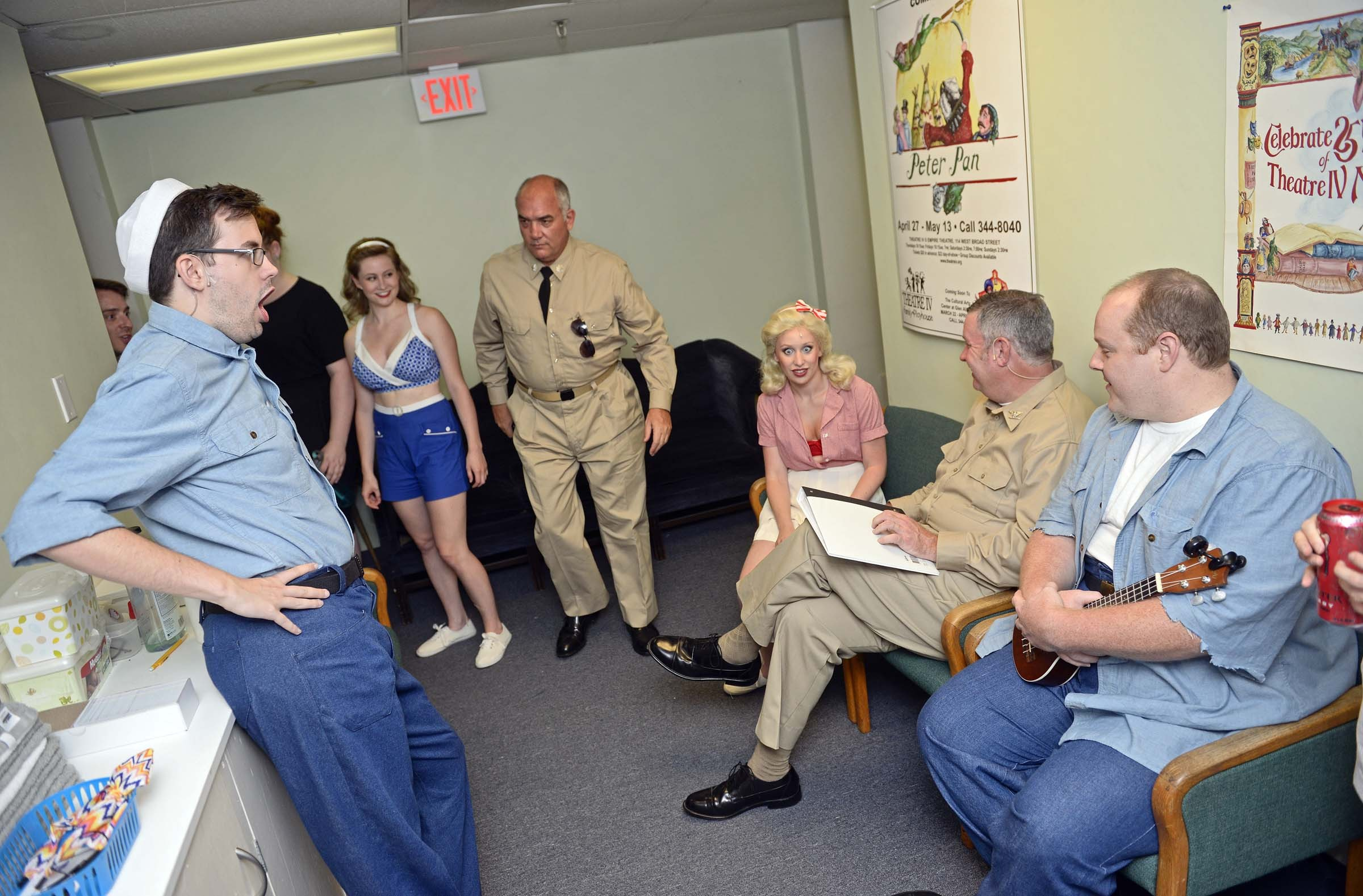 During a dress rehearsal last week, cast members await their call outside the dressing rooms. - ASH DANIEL