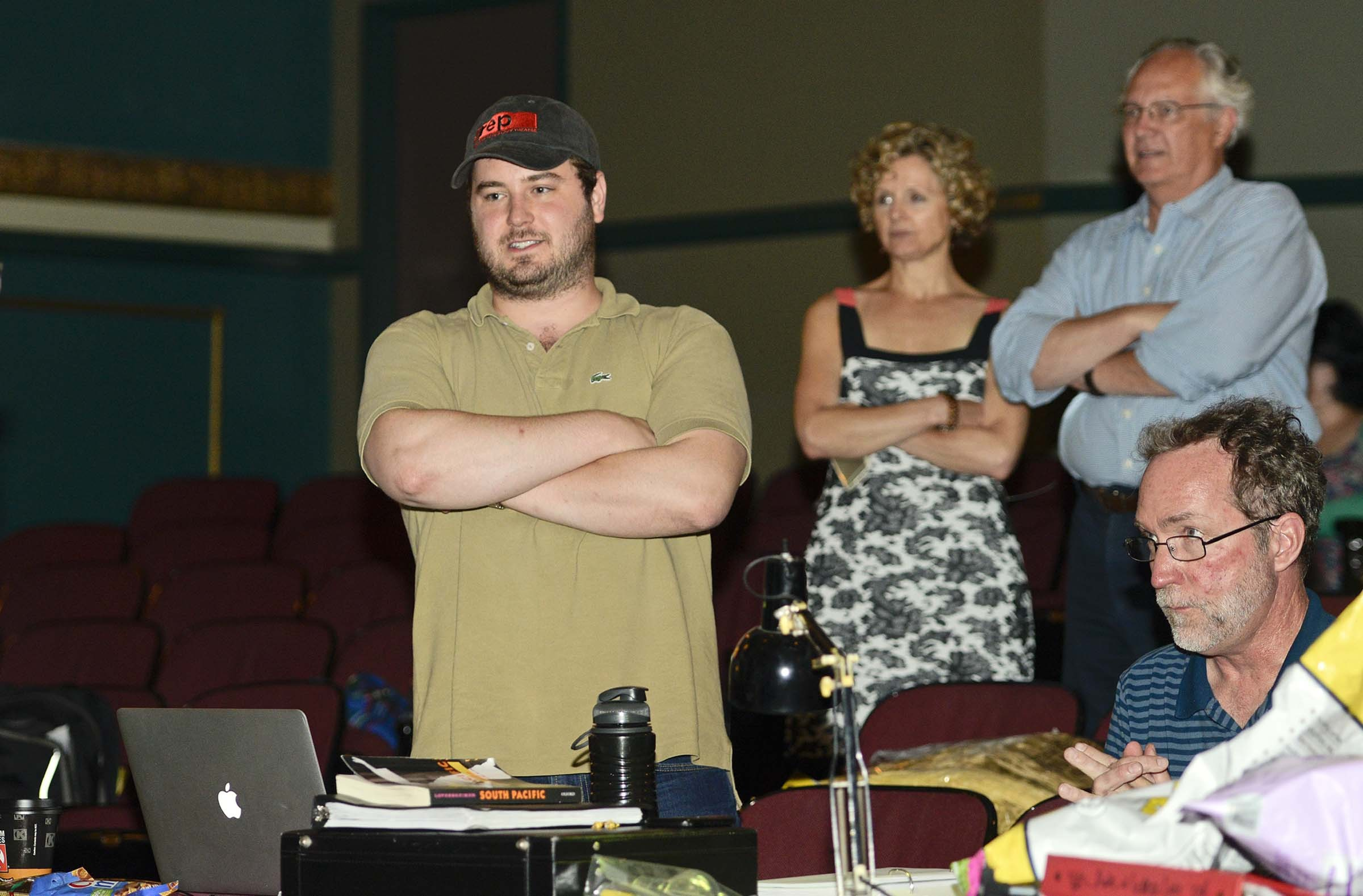 Kniffen watches the first full rehearsal with cast and orchestra with communications director Susan Davenport, the theater's managing director, Phil Whiteway, and stage manager Rick Brandt. - ASH DANIEL