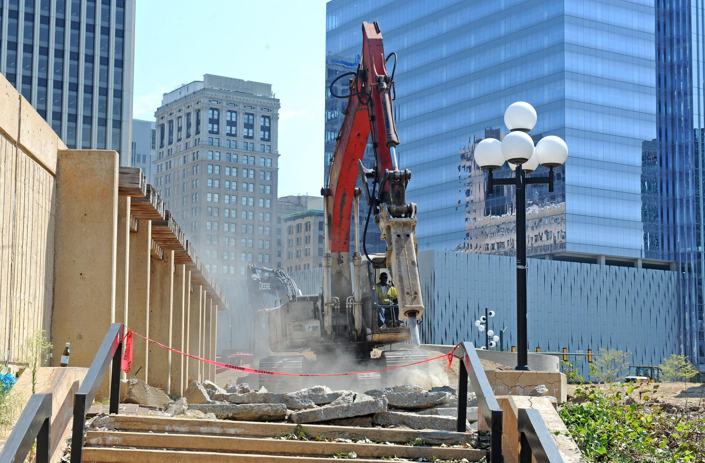 Immediately after Mayor Dwight Jones announced demolition of Kanawha Plaza on July 31, heavy equipment went into action. A reconfigured park, one of a number of public projects sparked by the cycling event, is scheduled for mid-September completion.