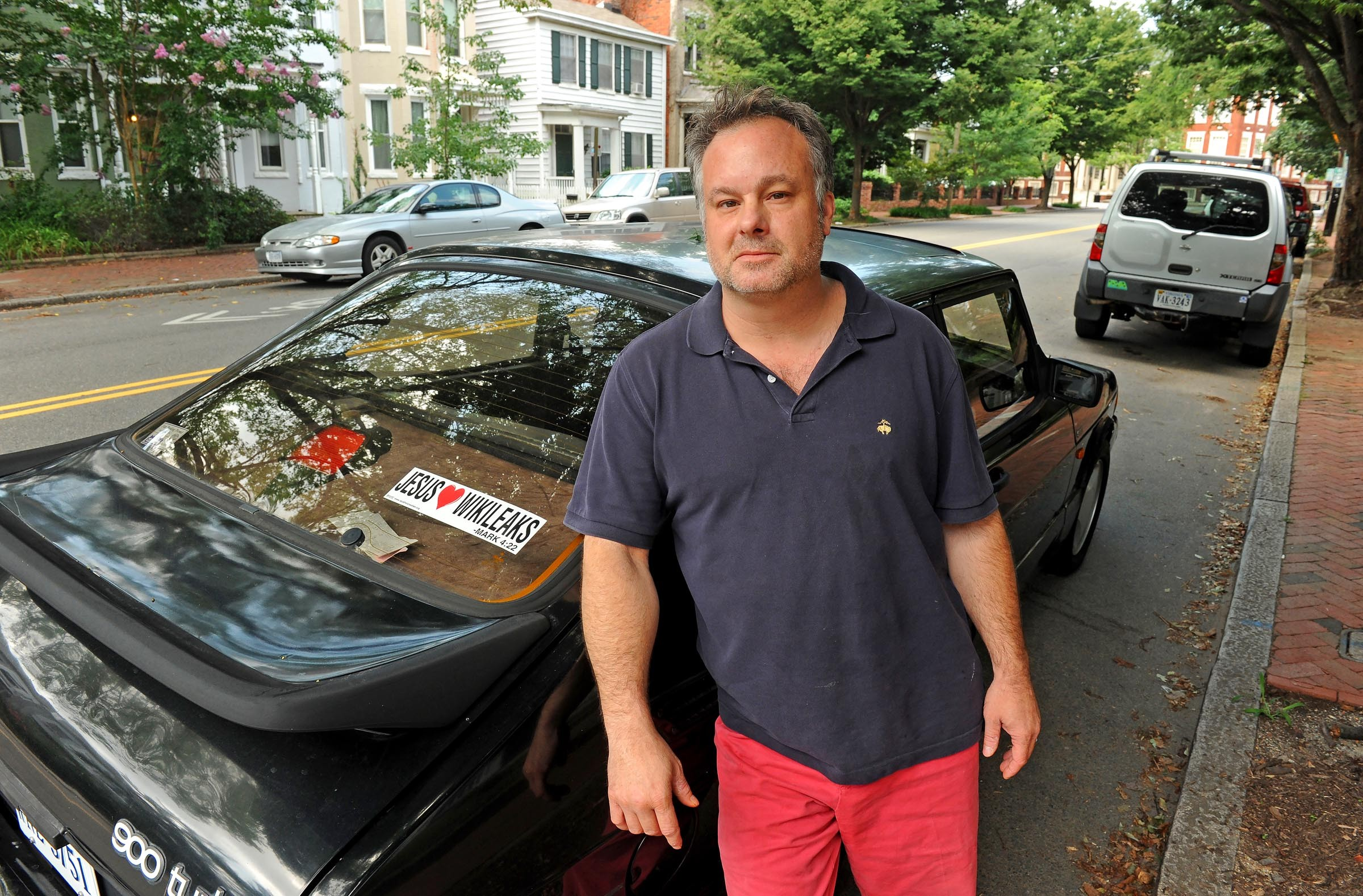 """Trevor FitzGibbon, founder and president of FitzGibbon Media, has a bumper sticker on  his car parked in the Fan that says, """"Jesus [heart] WikiLeaks,"""" with reference to a Bible passage from Mark 4:22: """"For there is nothing hid, which shall not be manifested; neither was any thing kept secret, but that it should come abroad."""" - SCOTT ELMQUIST"""