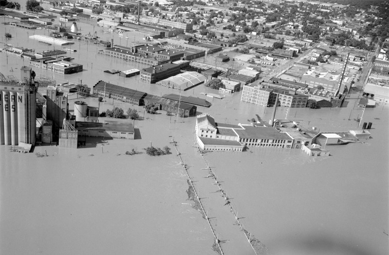 The 14th Street Bridge underwater. The famous Southern States silos are barely visible to the left. Style Weekly's offices are in the building with the domed roof in the middle of the photo. - THE LIBRARY OF VIRGINIA