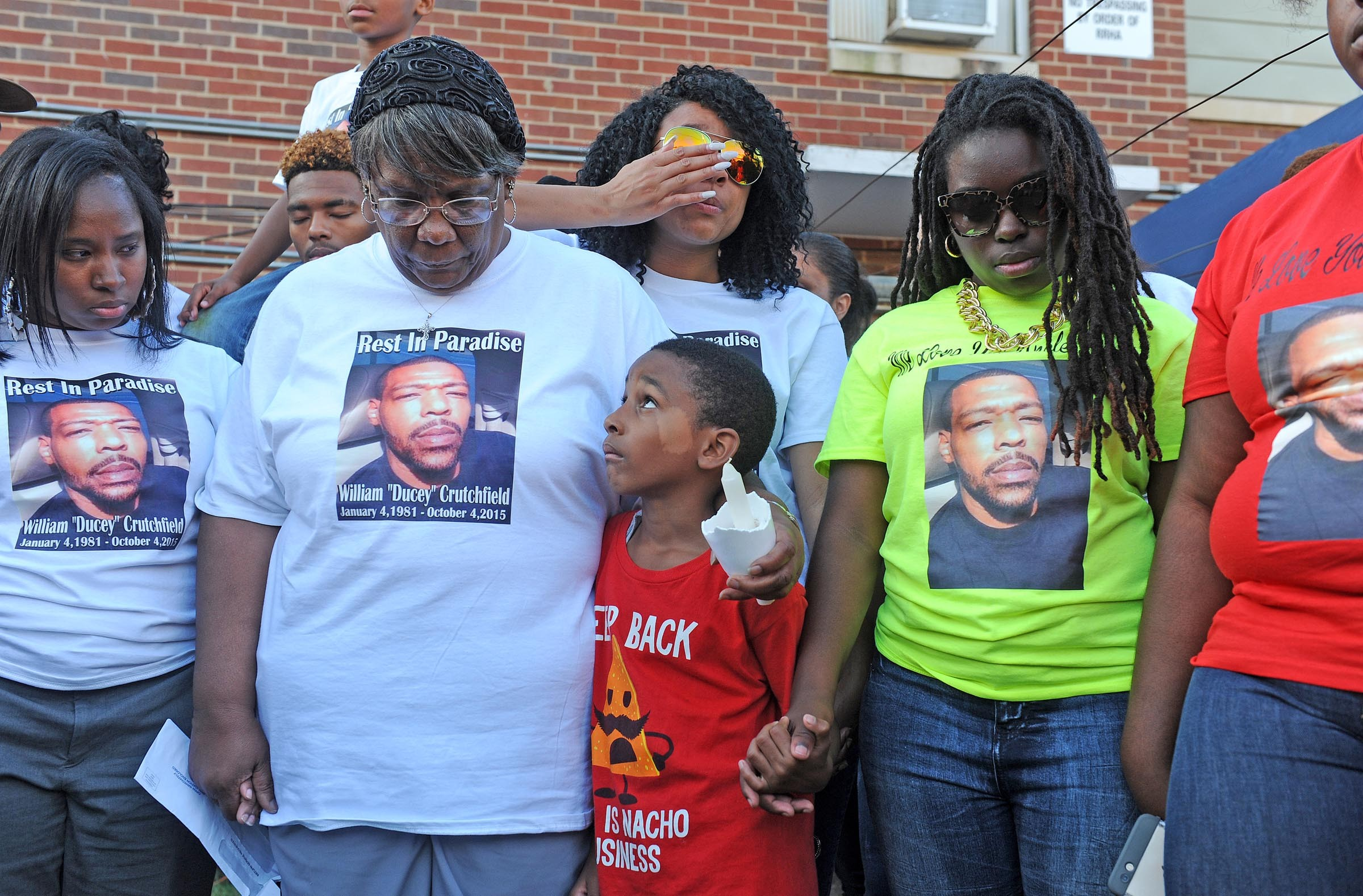 Members of William Crutchfield's family gather at his vigil in October, wearing T-shirts to honor him. - SCOTT ELMQUIST