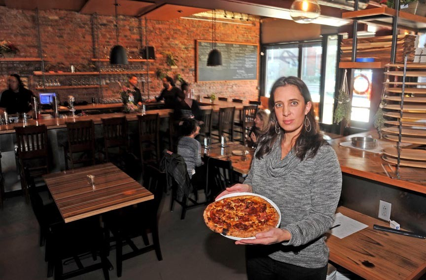 Pizza may have started owner Victoria Deroche's business, but her new restaurant expands the menu far beyond the confines of a pie. - SCOTT ELMQUIST
