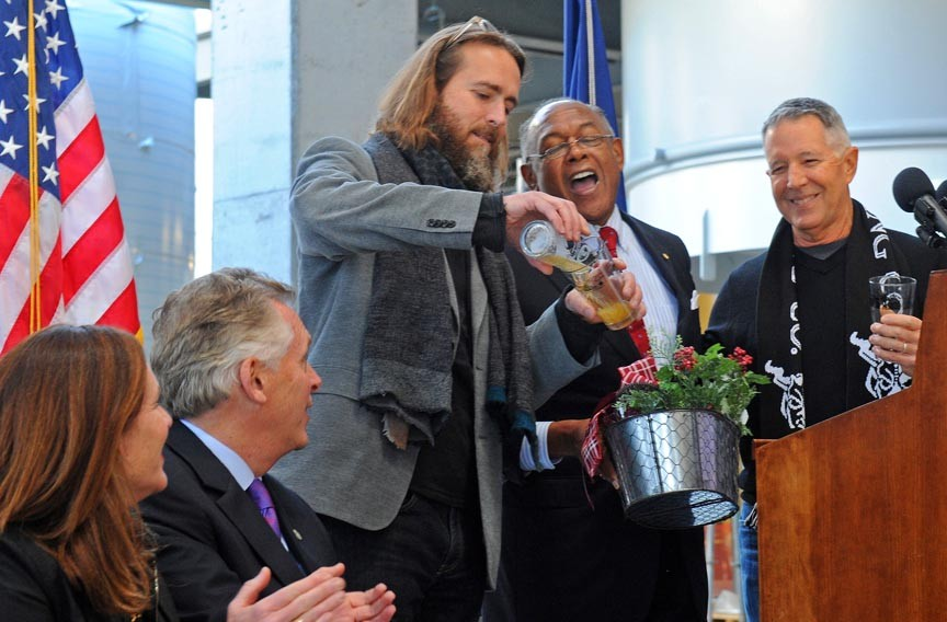 Greg Koch, co-founder of Stone Brewing, pours a brew into a City of Richmond beer glass. City, state and company officials recently met at Stone's Fulton Hill brewery to toast its construction progress. - SCOTT ELMQUIST